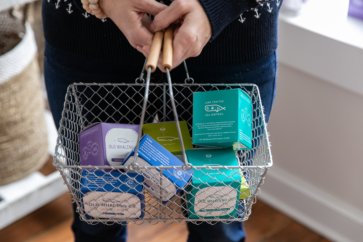 Women holding a basket of Bar Soaps and Bath Bombs